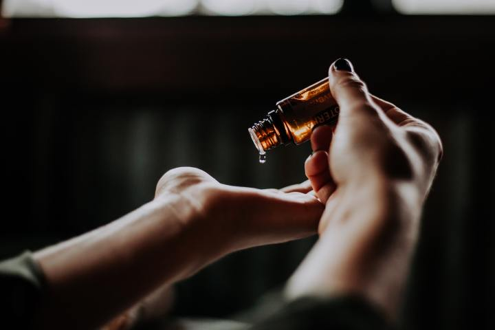 hand holding essential oil